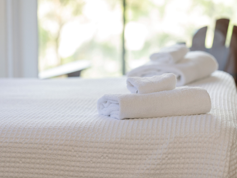 towels on bed for bed and breakfast stay - Hazelmont Cottage